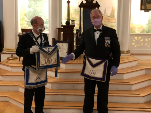 "At the Regular Communication, September 14th, Wor. Master Frederick J. Bowe received his Past Master's Certificate, Past Master's Apron, and Past Master's Jewel from Rt Wor. Douglas J. Ellis who was acting as the District Deputy Grand Master of the 14th Masonic District for the Rt. Wor. John C. Toto during an Official Visit to Corinthian Lodge. Rt. Wor. Ellis noted that the Past Master Apron was originally from Rt. Wor. John H. Hart (1961-1962); passed to, Rt. Wor. Ellis (2014-2016); and now, to Wor. Bowe. Wor. Master Bowe thanked the Officers and members of the Lodge for their untiring efforts throughout his tenure. He especially, thanked all the Past Masters who lent their guidance, recommendations, and assistance to him. In appreciation to his Officers, Wor. Master Bowe presented each officer with a Masonic embossed 'facemask' as a remembrance of the unique ""pandemic year of 2020."" Congratulations Wor. Bowe!"